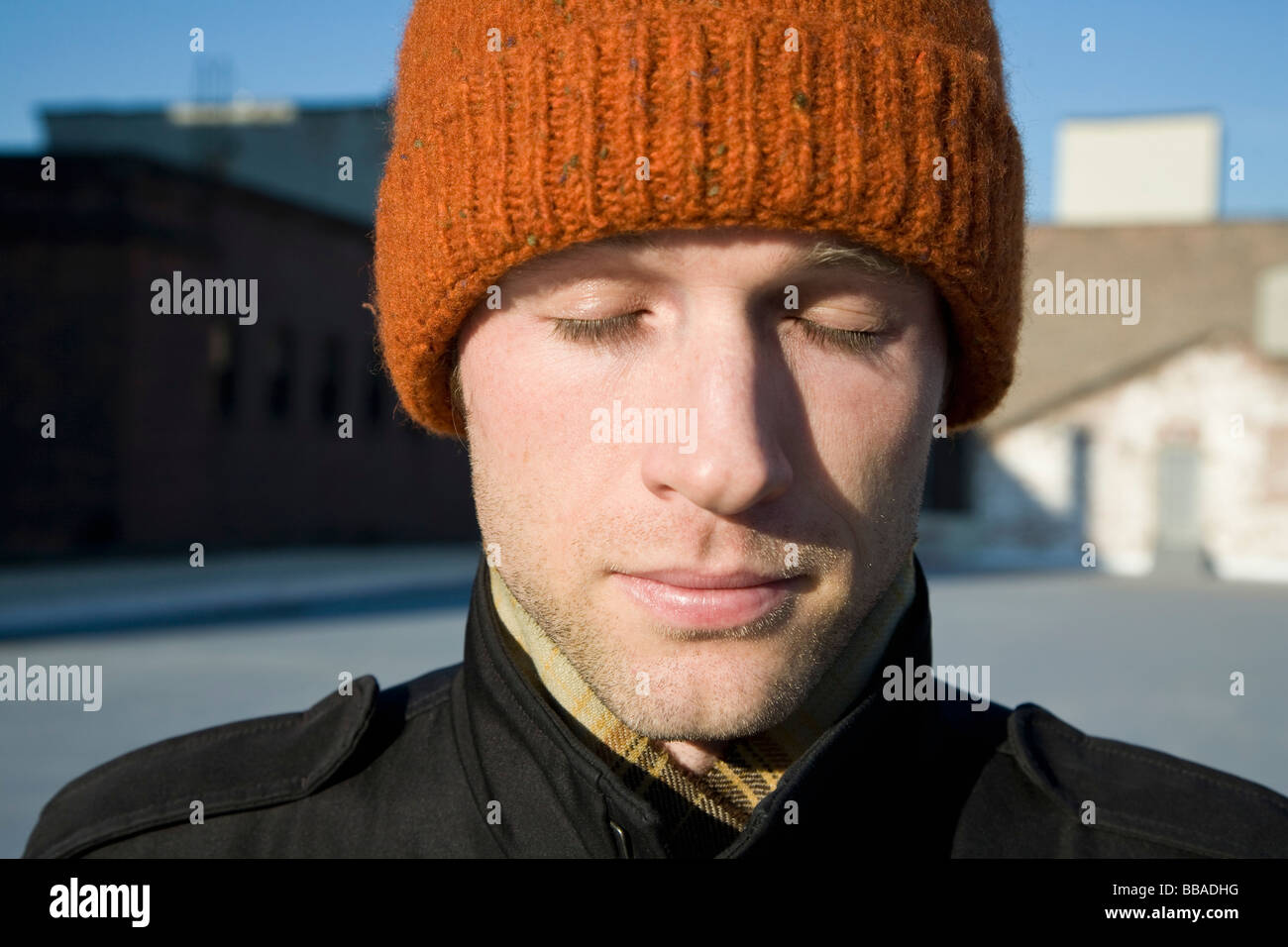 A man with a knit hat, portrait - Stock Image