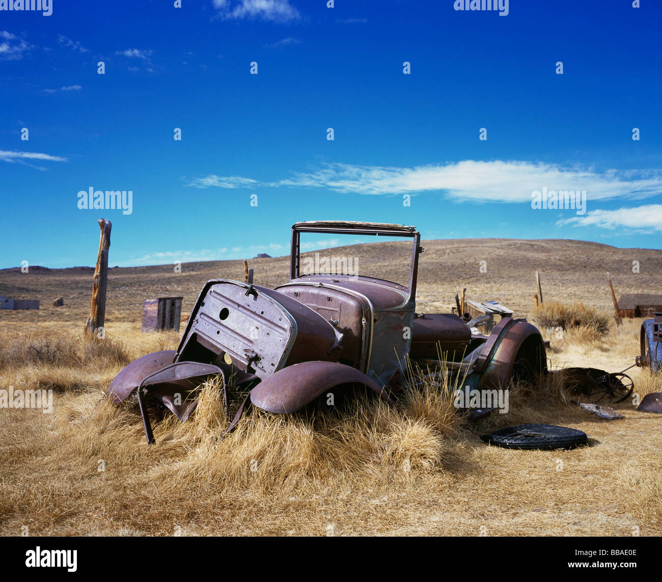 An old abandoned car in a field, Bodie State Historic Park, California, USA - Stock Image