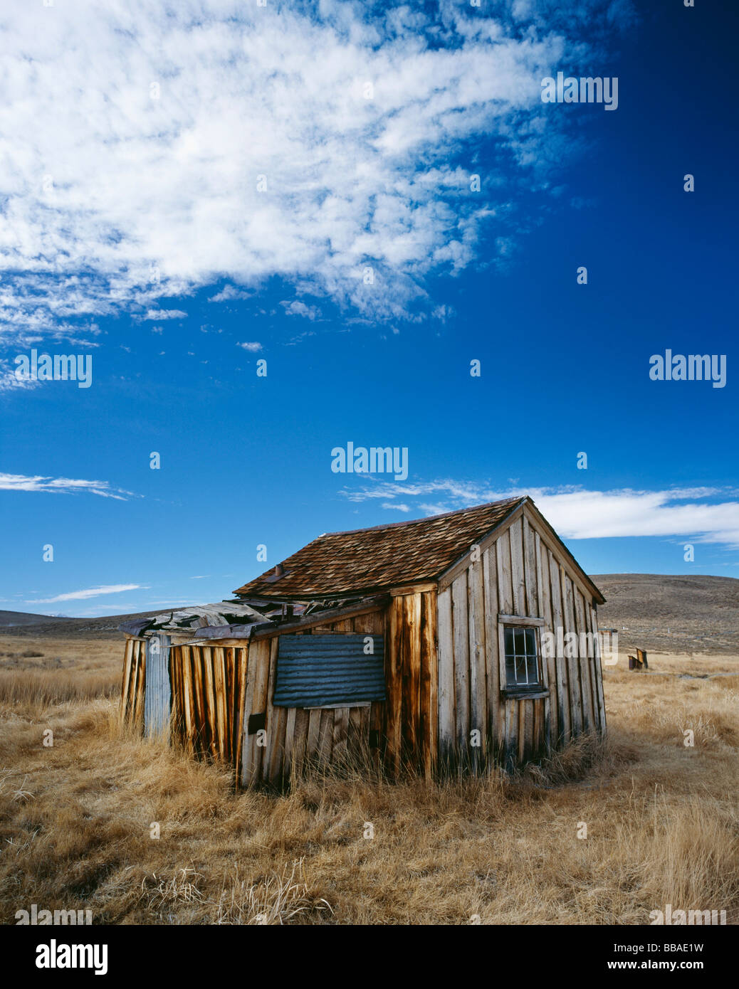 A wooden shack in a field, Bodie State Historic Park, California, USA - Stock Image
