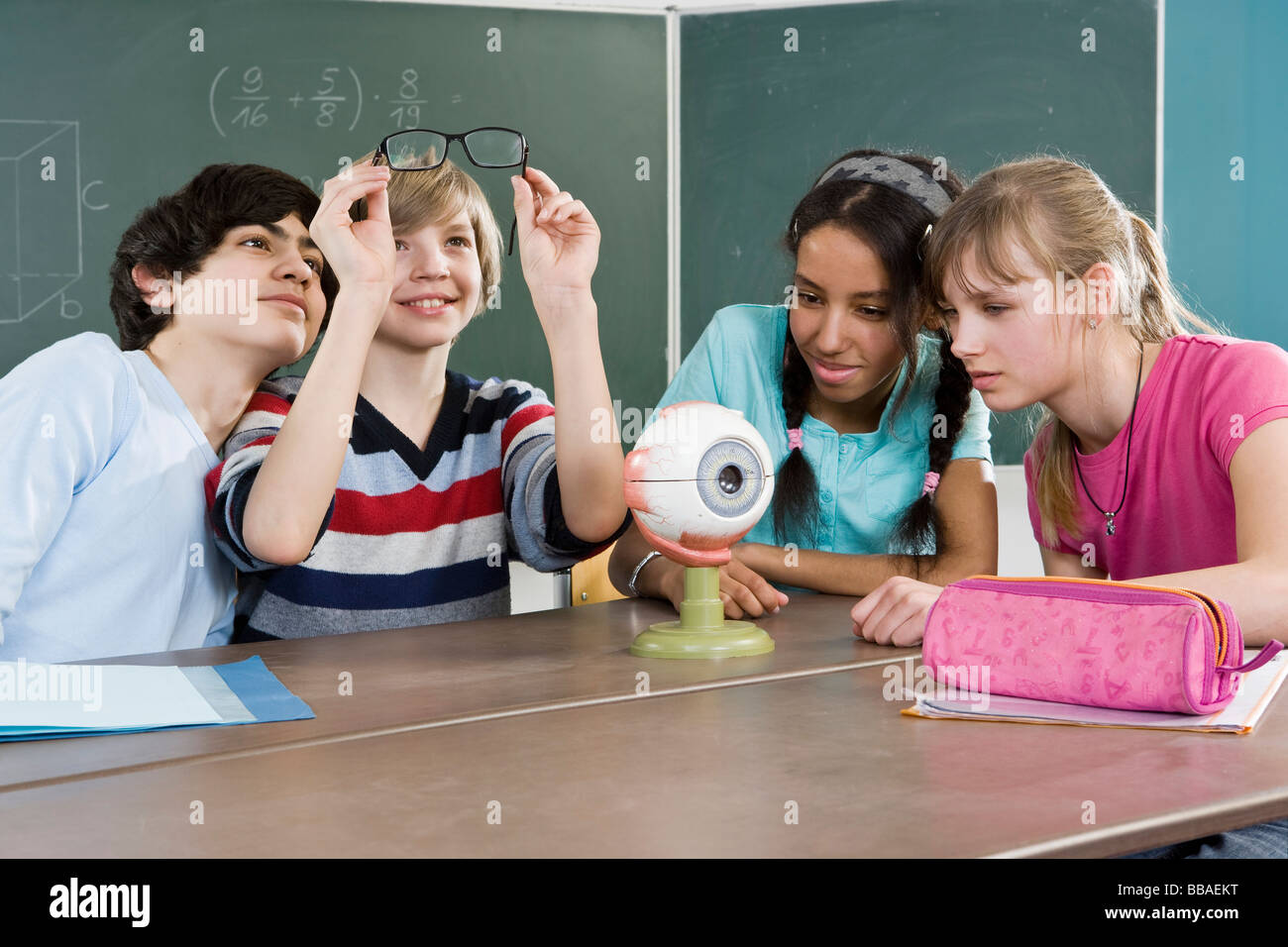 School students sitting together in a classroom - Stock Image