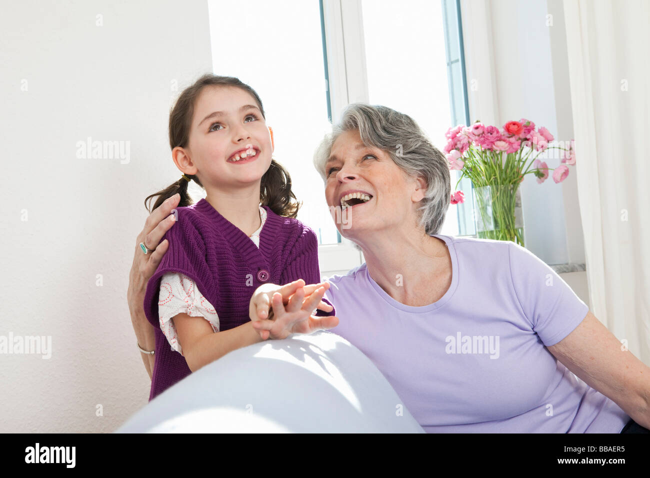 A grandmother and granddaughter spending time together - Stock Image