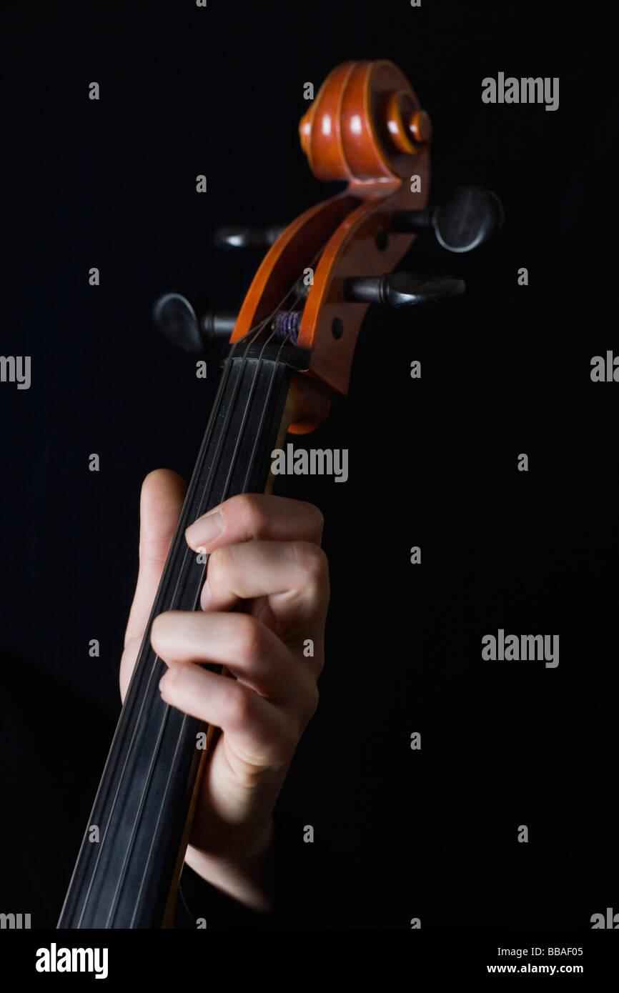 Human hand playing a cello - Stock Image