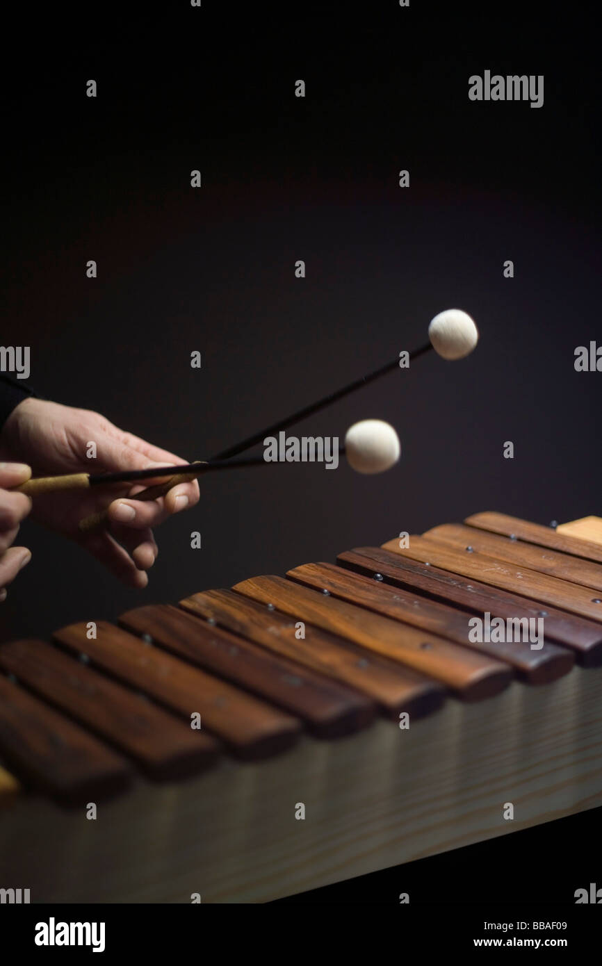 Human hands playing a xylophone - Stock Image