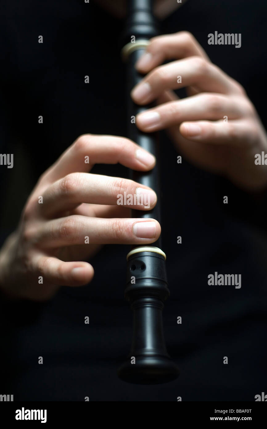 Human hands playing a recorder - Stock Image