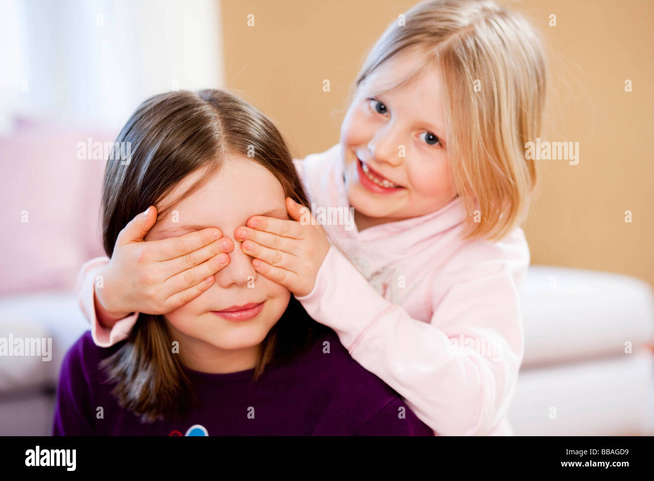 young sisters playing - Stock Image