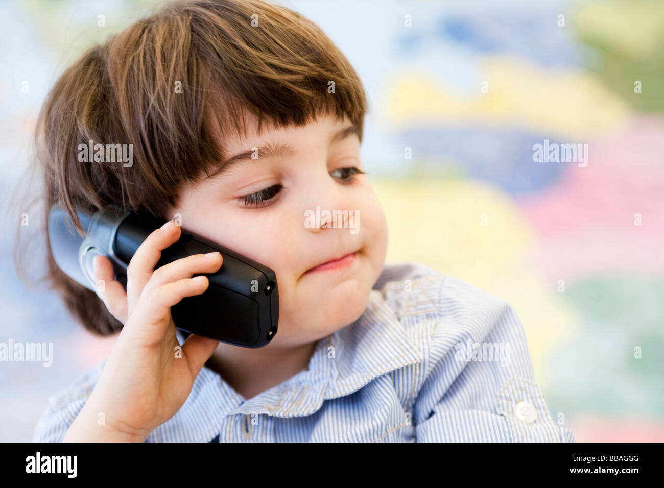 young boy phoning - Stock Image