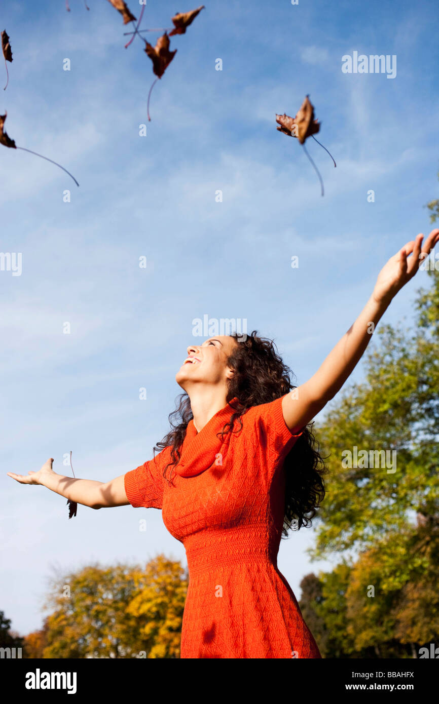 young woman under blue sky - Stock Image