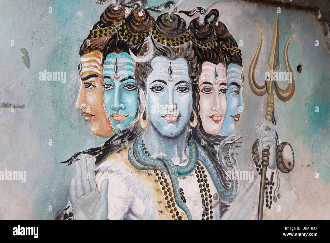 Shiva carrying a trident is painted onto a wall in Chennai, India. - Stock Image