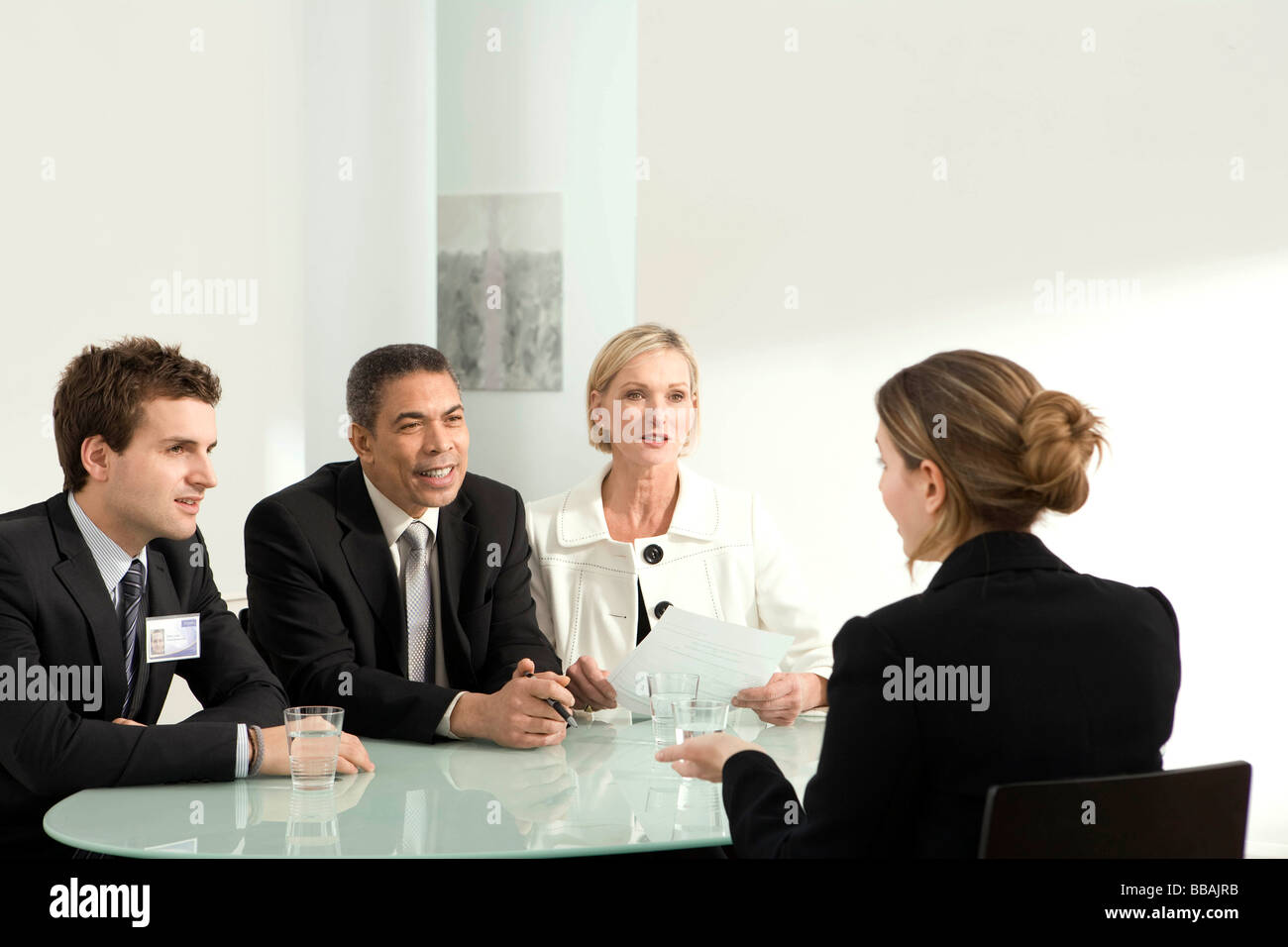 An interview in front of a panel - Stock Image