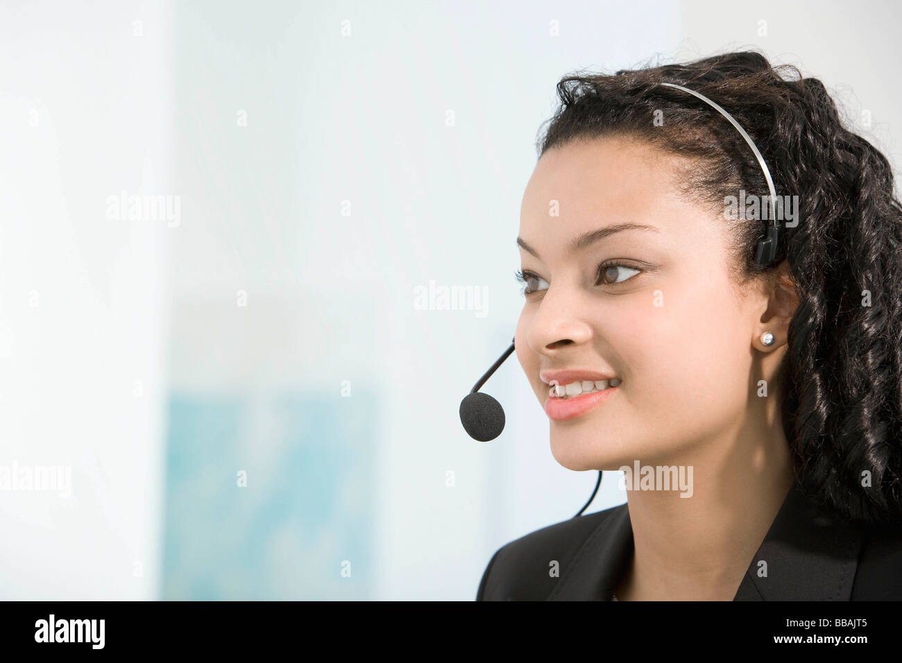 A telephone operator talking into a mic - Stock Image