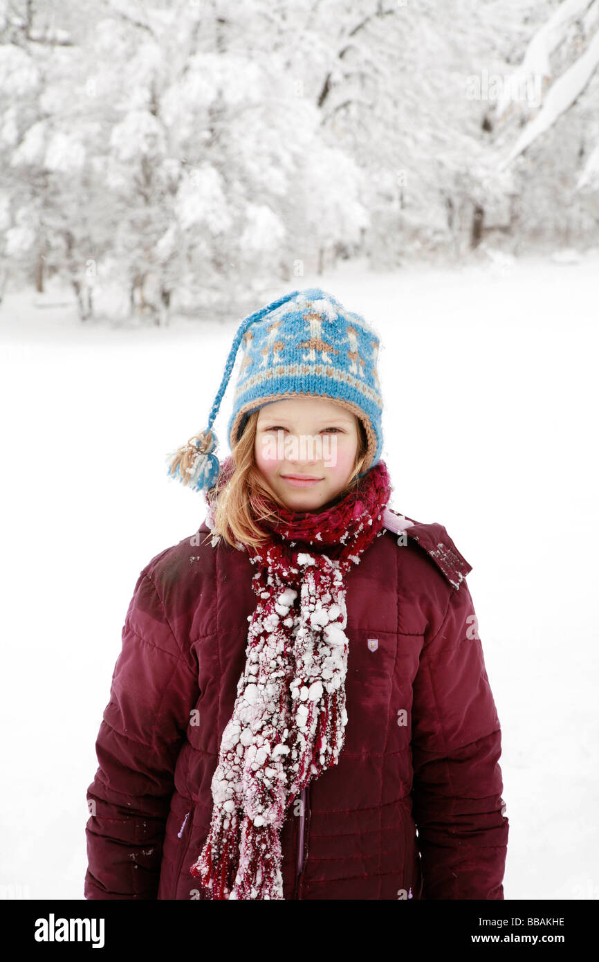 Girl covered in deep snow - Stock Image