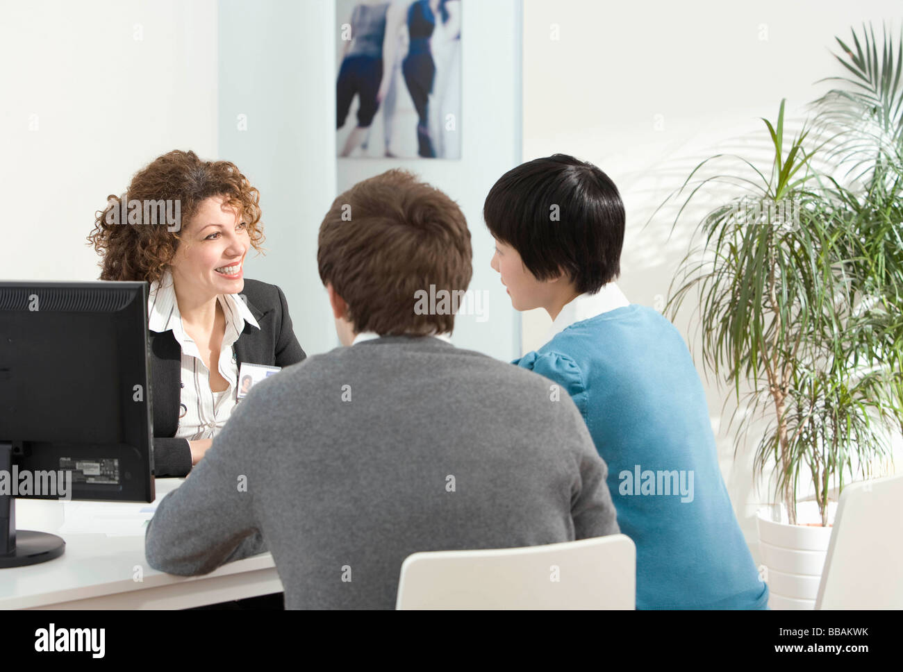 A couple meet with a mortgage adviser - Stock Image
