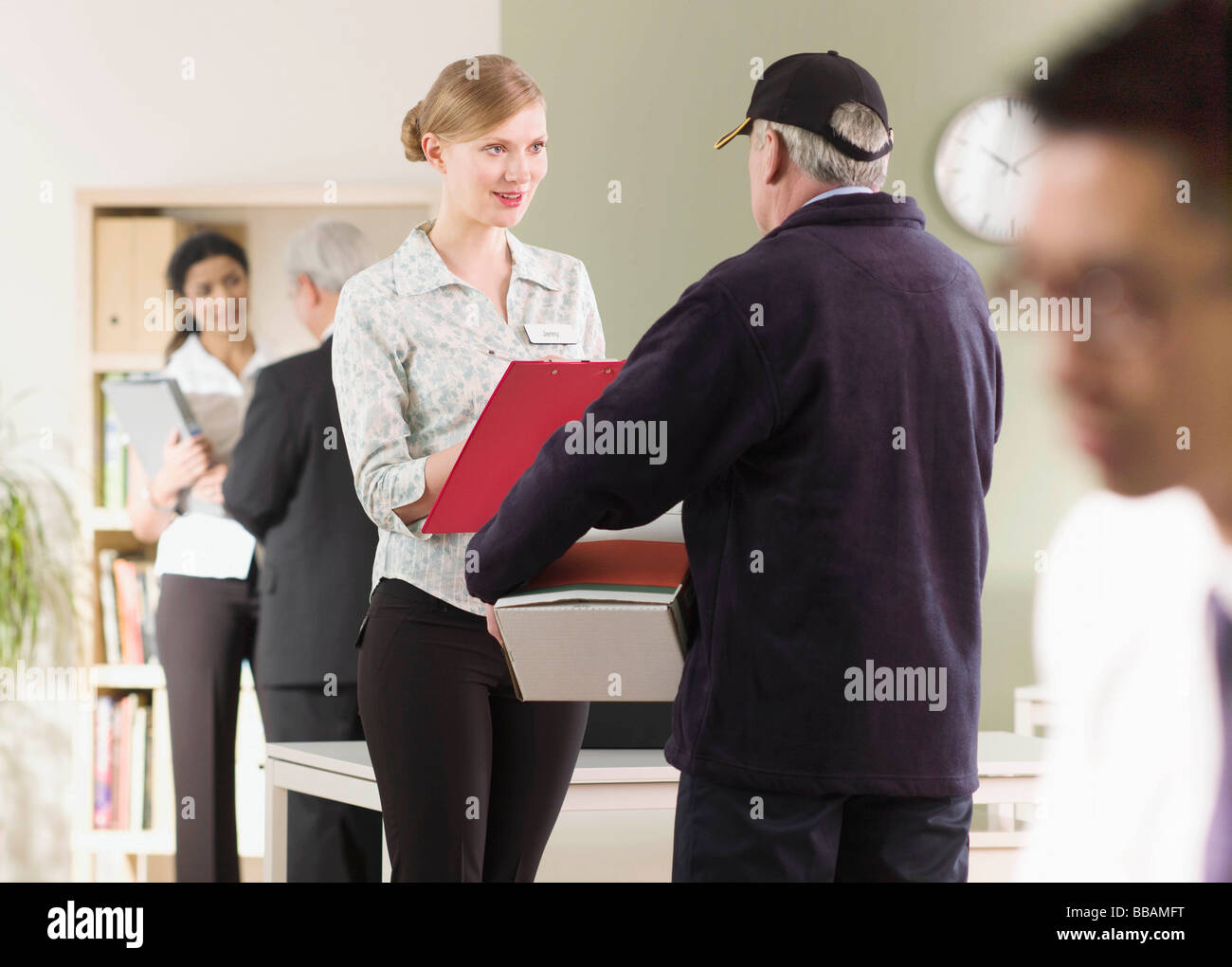 A delivery arrives at an office - Stock Image
