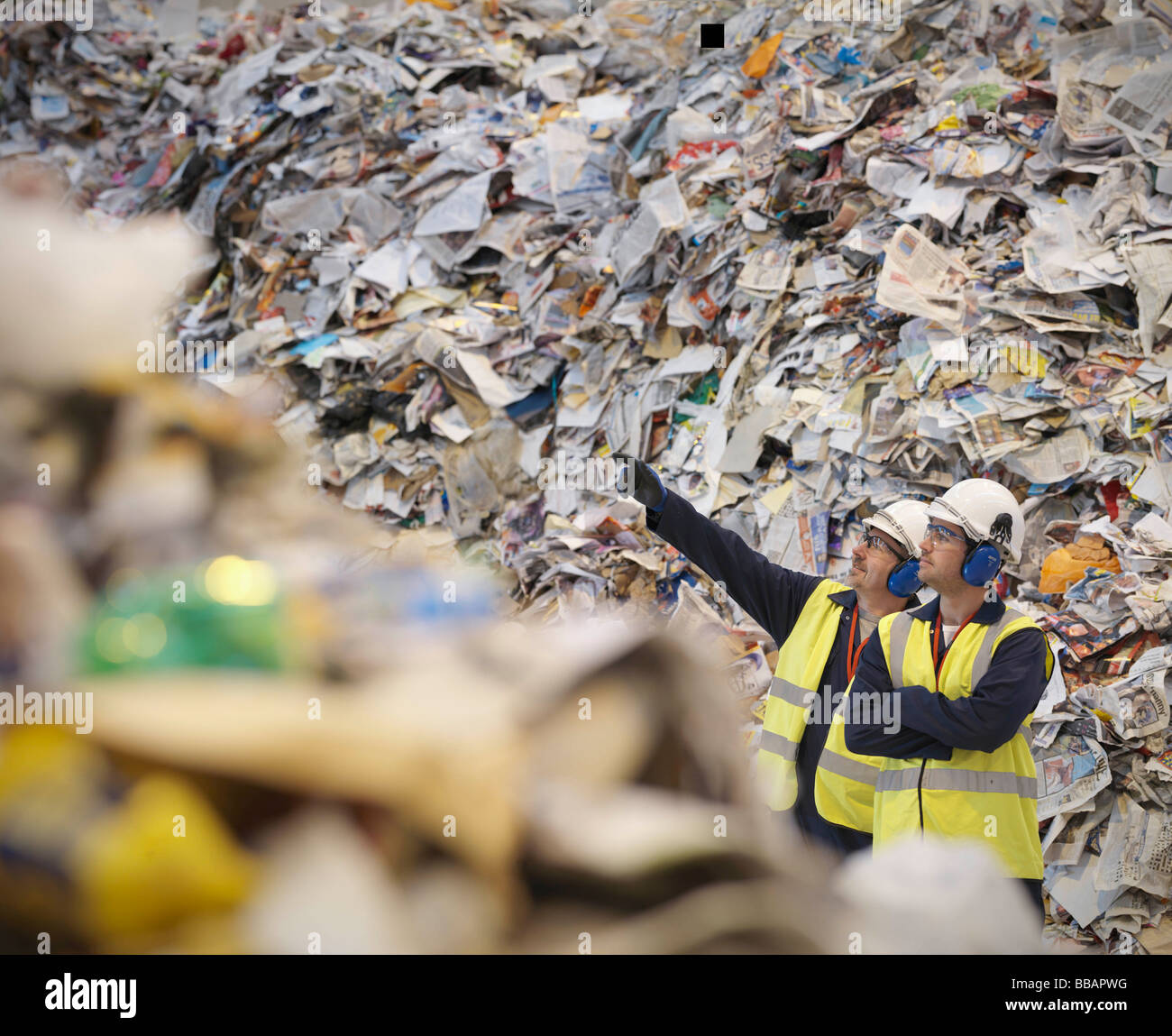 Workers With Paper In Recycle Plant - Stock Image