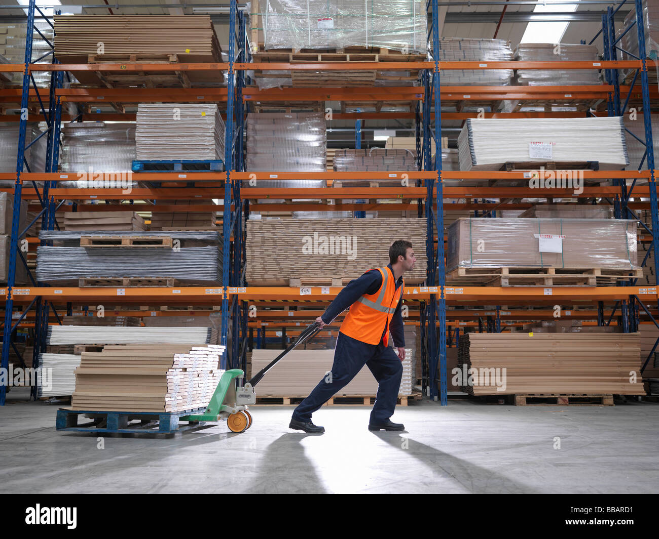 Worker Transporting Product In Warehouse - Stock Image