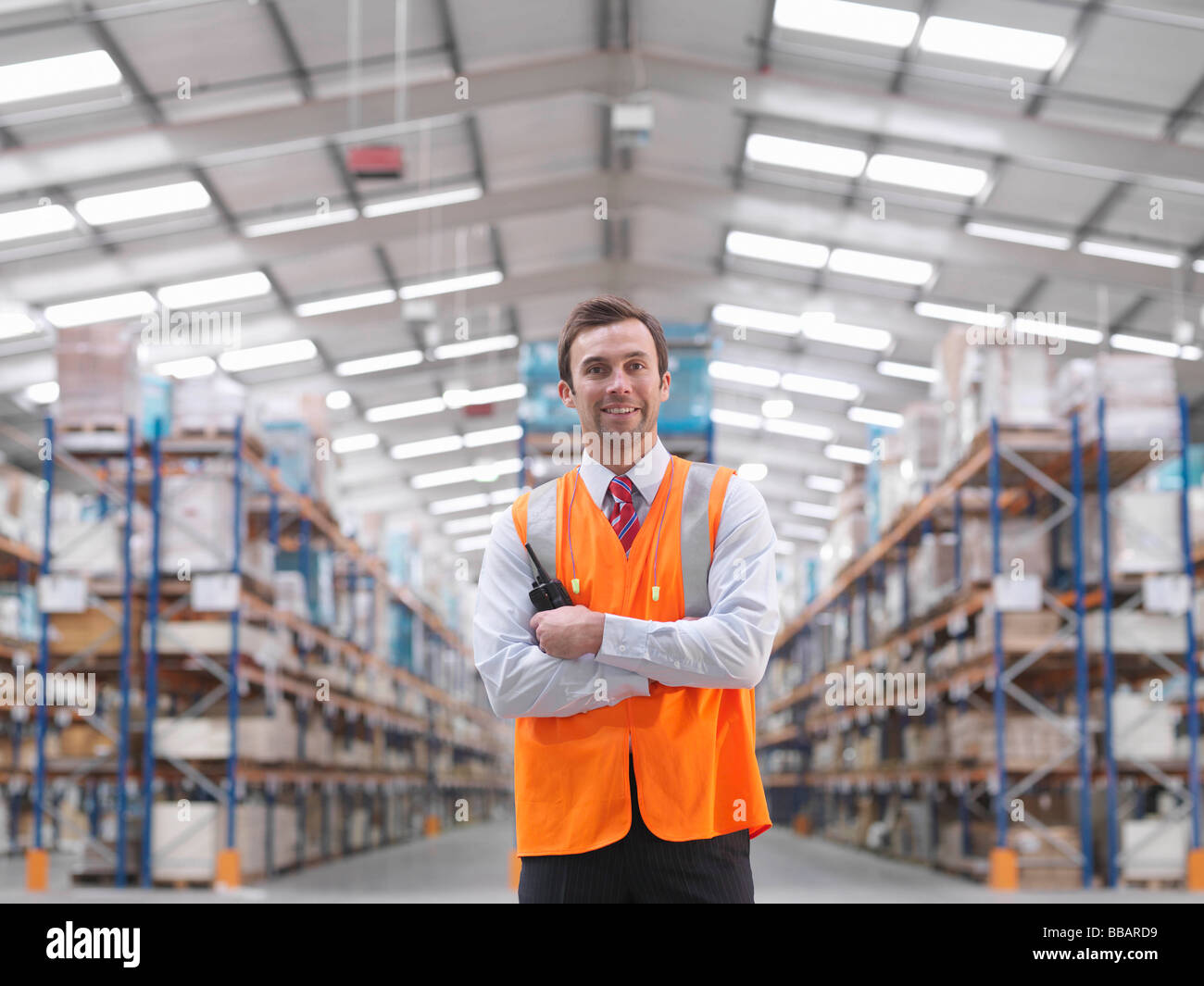 Warehouse Manager With Walkie Talkie - Stock Image