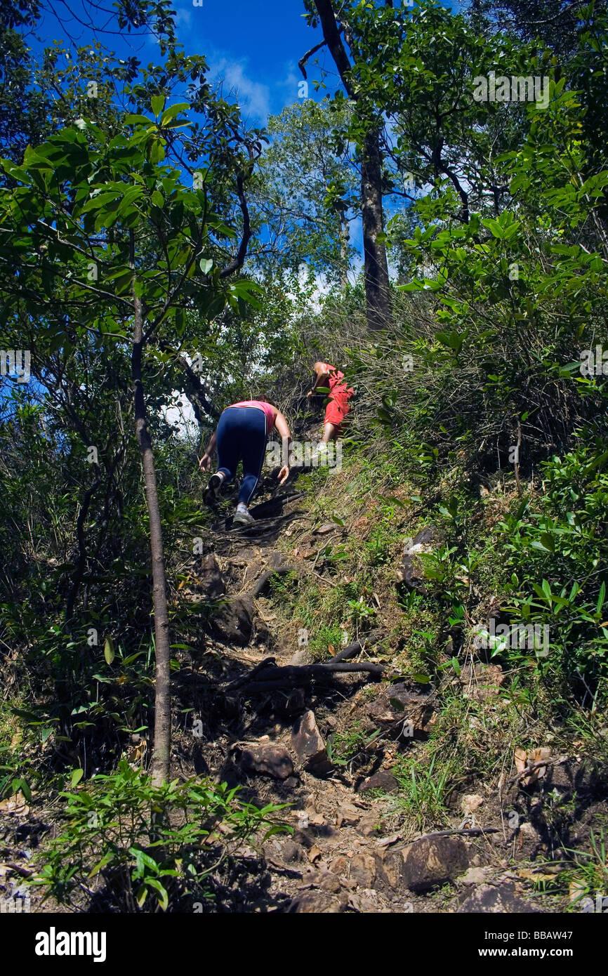 Trekkers on Agua Fria Waterfall Track Chapada dos Veadeiros Veadeiros Tableland Goias Brazil Stock Photo