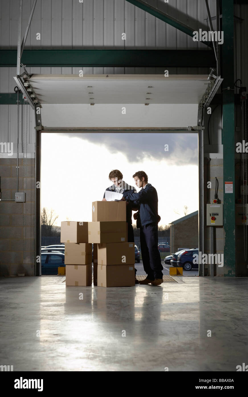 Two workers in warehouse Stock Photo
