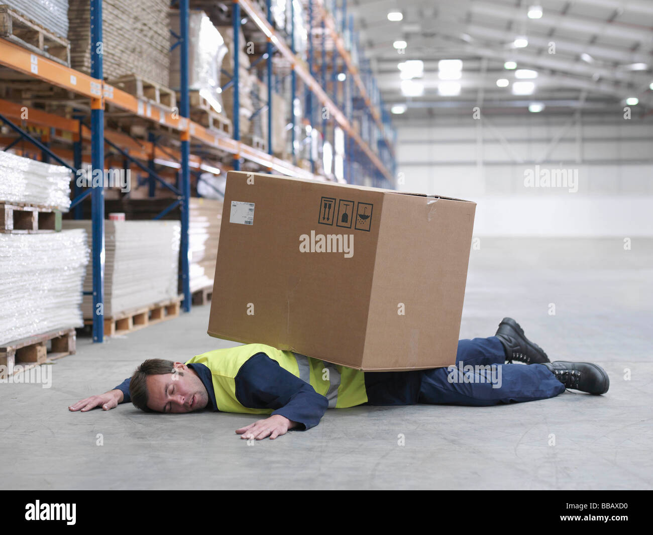 Worker Flattened By Box In Warehouse - Stock Image
