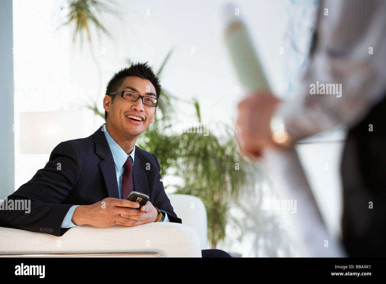 Business colleagues meet in al lobby - Stock Image