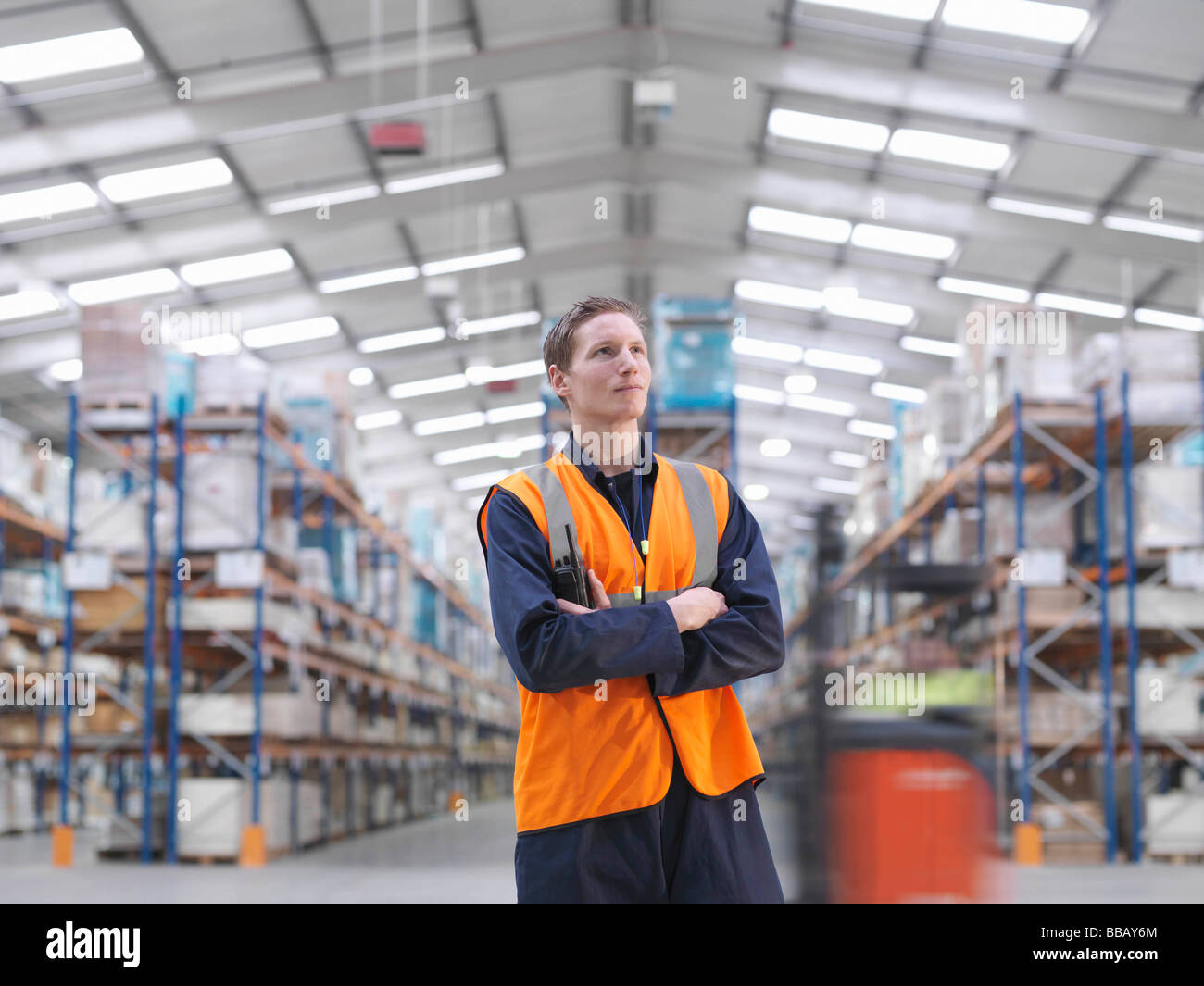 Worker With Walkie Talkie In Warehouse - Stock Image