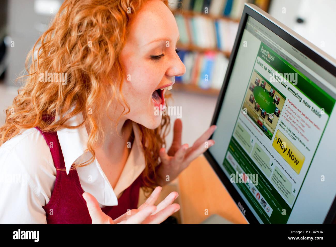 Girl online using computer - Stock Image