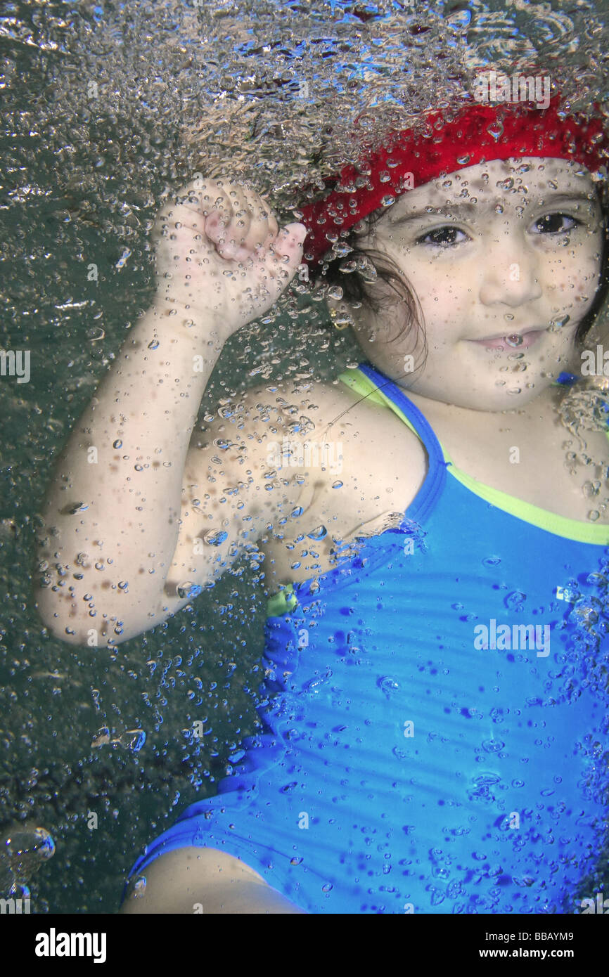 Underwater picture of a girl swimming and playing with joy Stock Photo
