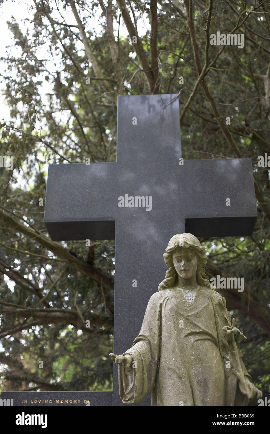 cross and statue Stock Photo