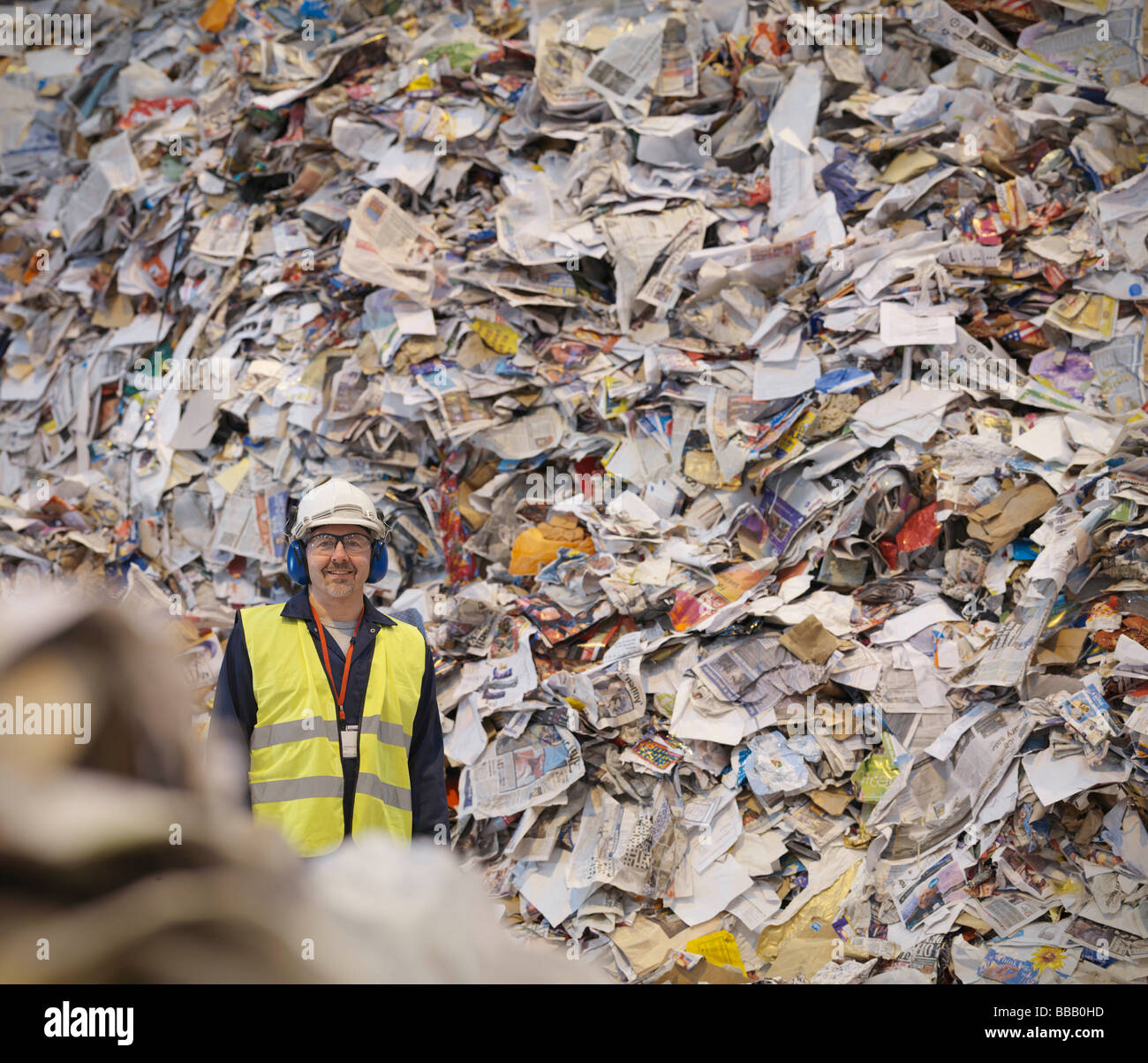Worker With Paper In Recycle Plant - Stock Image