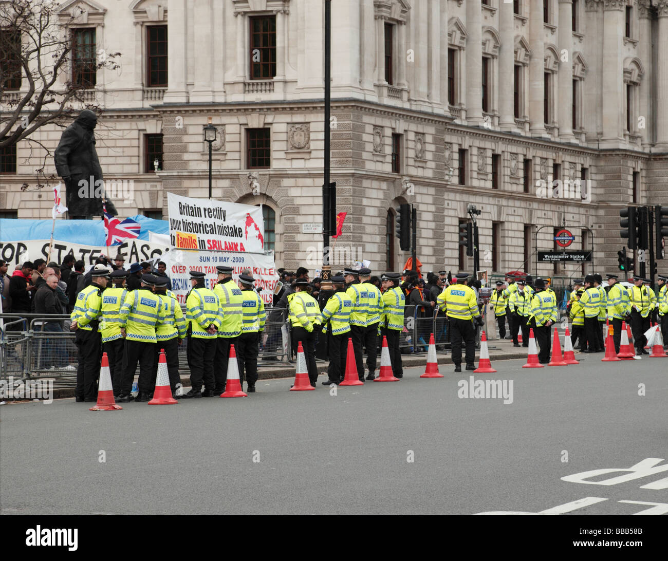 Policing of Tamil protesters demonstrating over the fighting in Sri Lanka outside Parliament London England UK. - Stock Image