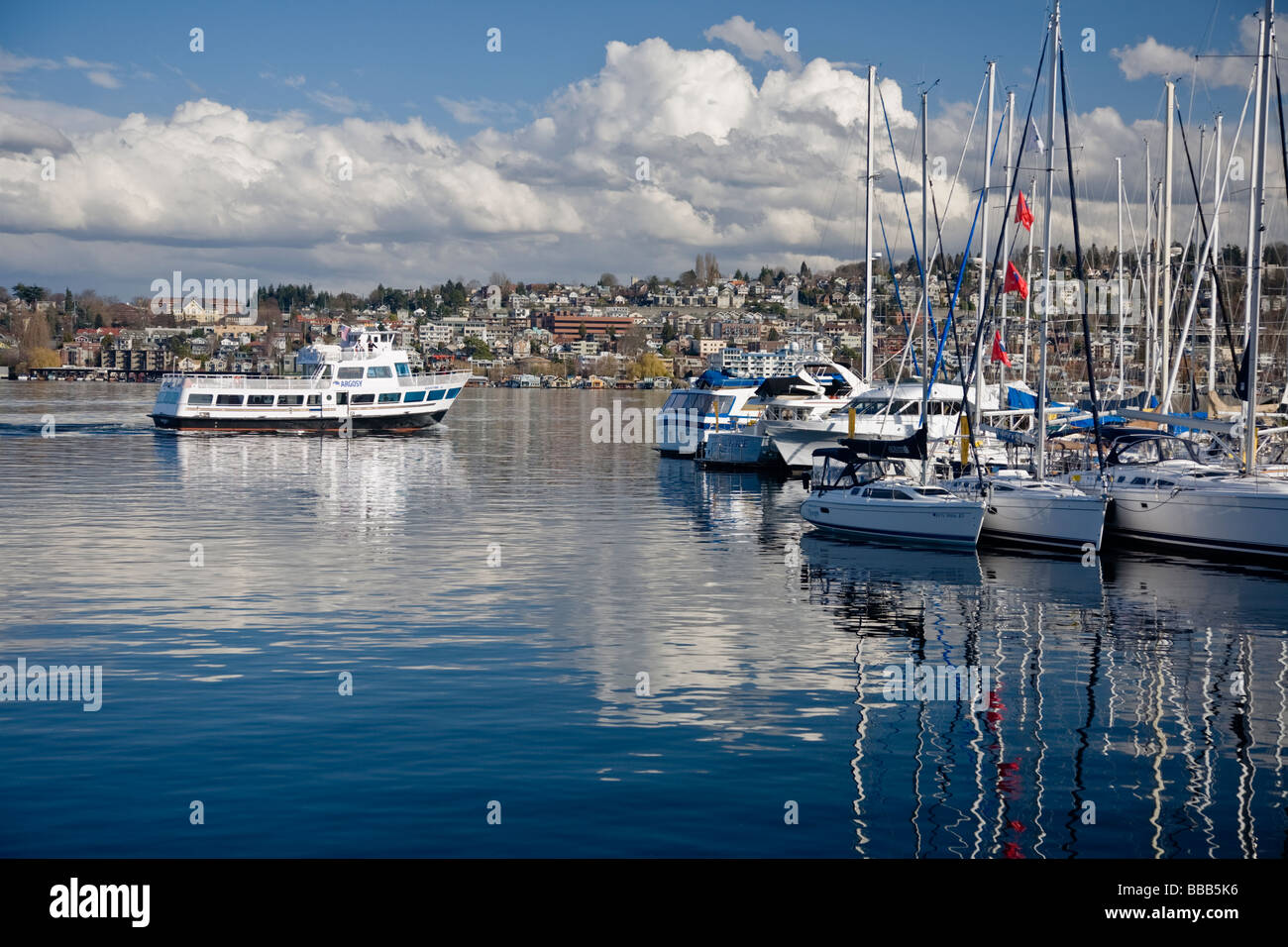 Seattle, WA: Clouds over First Hill and Eastlake neighborhoods with Argosy tour boat on Lake Union - Stock Image