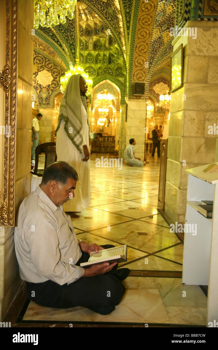 Men praying inside the Sayyida Ruqayya mosque Damascus - Stock Image