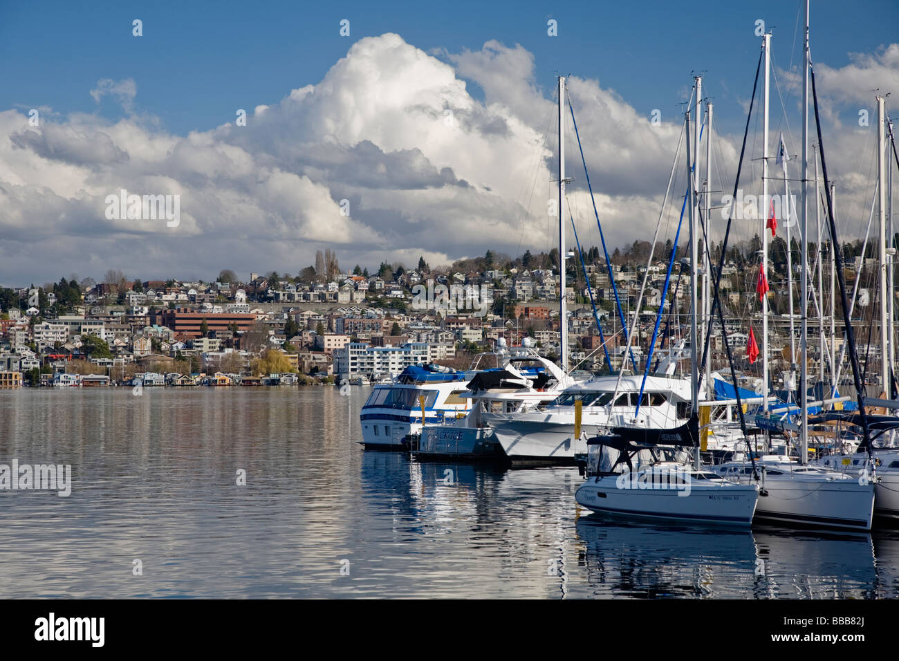Seattle WA Clouds over First Hill and Eastlake neighborhoods with sailboat reflections on Lake Union - Stock Image