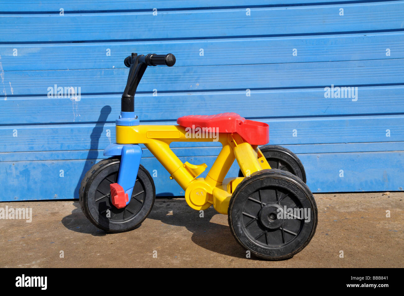 a young child's tricycle. - Stock Image