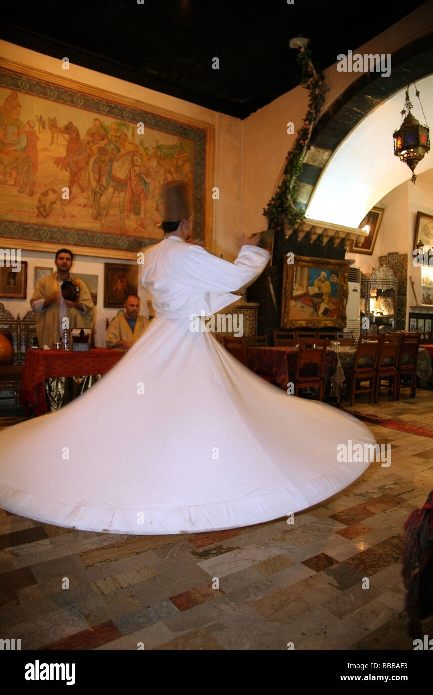 Sufi dancer or whirling dervish at a traditional restaurant Damascus - Stock Image