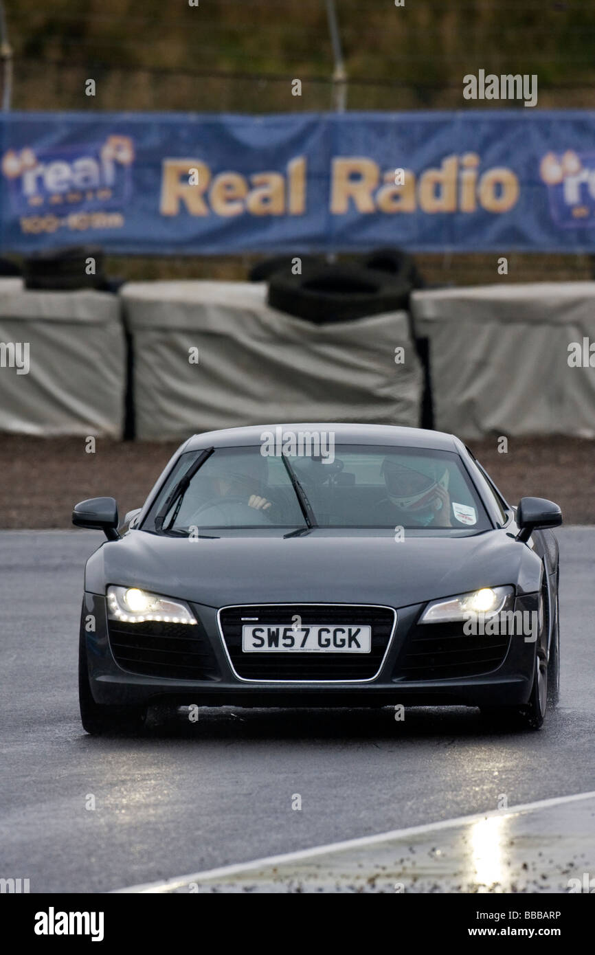 Audi R8 Supercar on wet track Stock Photo