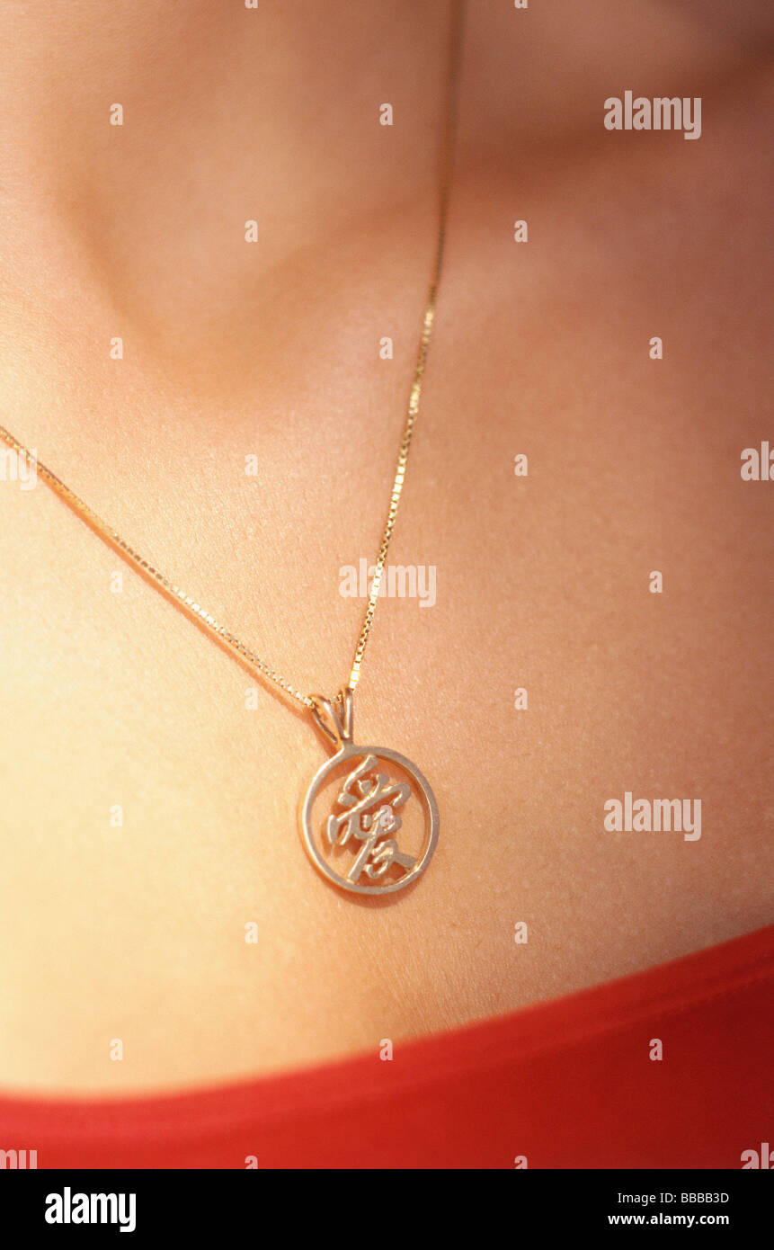Woman wearing gold chain with pendant stock photo 24221777 alamy woman wearing gold chain with pendant aloadofball Gallery
