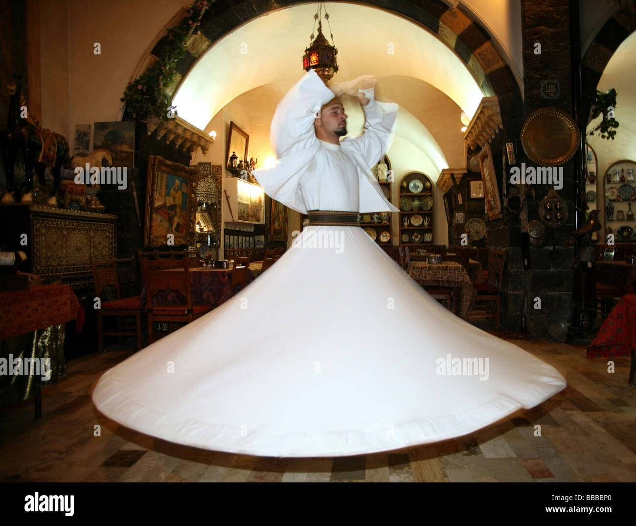 Sufi dancer or whirling dervish at a traditional restaurant Damascus Stock Photo