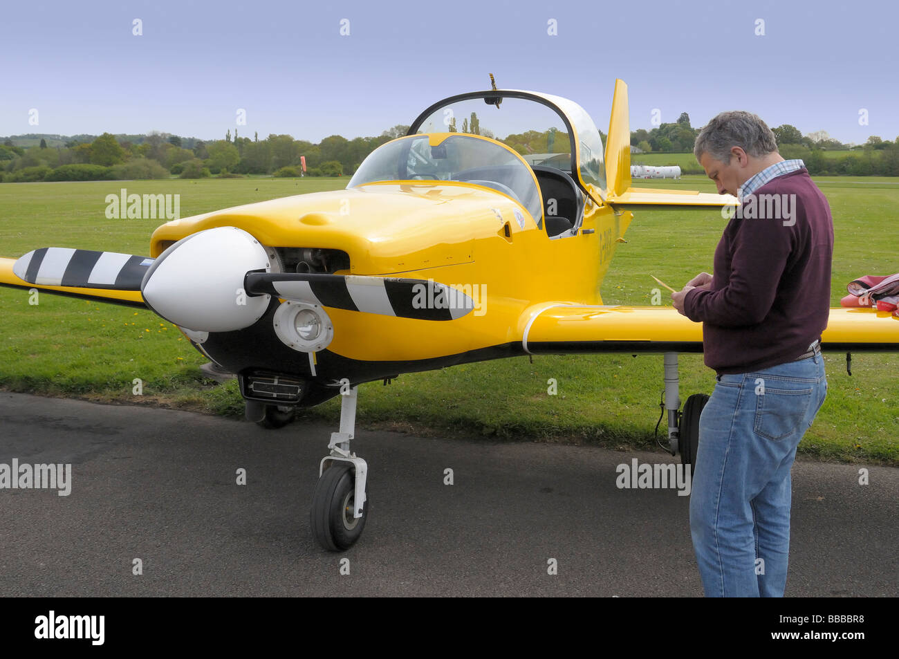 Pilot preparing for takeoff in Slingsby Firefly light aircraft at Redhill Surrey UK - Stock Image