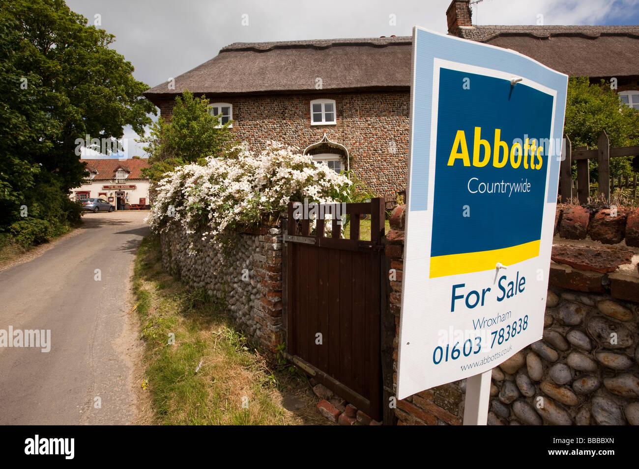 UK England Norfolk Happisburgh thatched cottage for sale - Stock Image