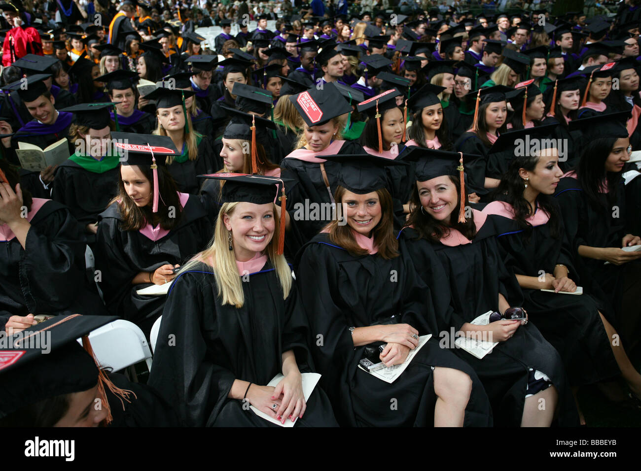 Yale University graduates smile as they receive their