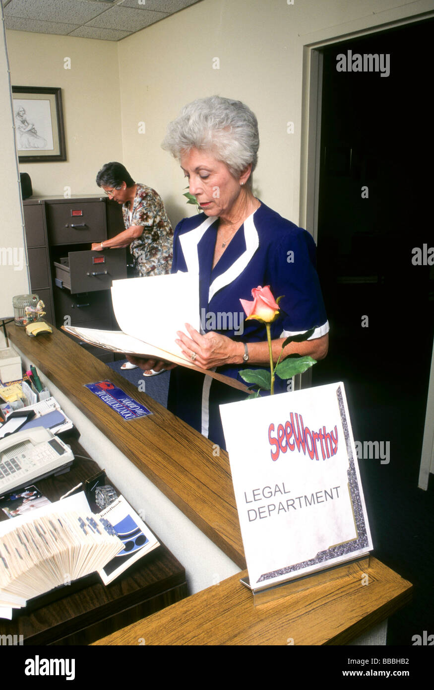 women office work file sort read law secretary serious mature senior