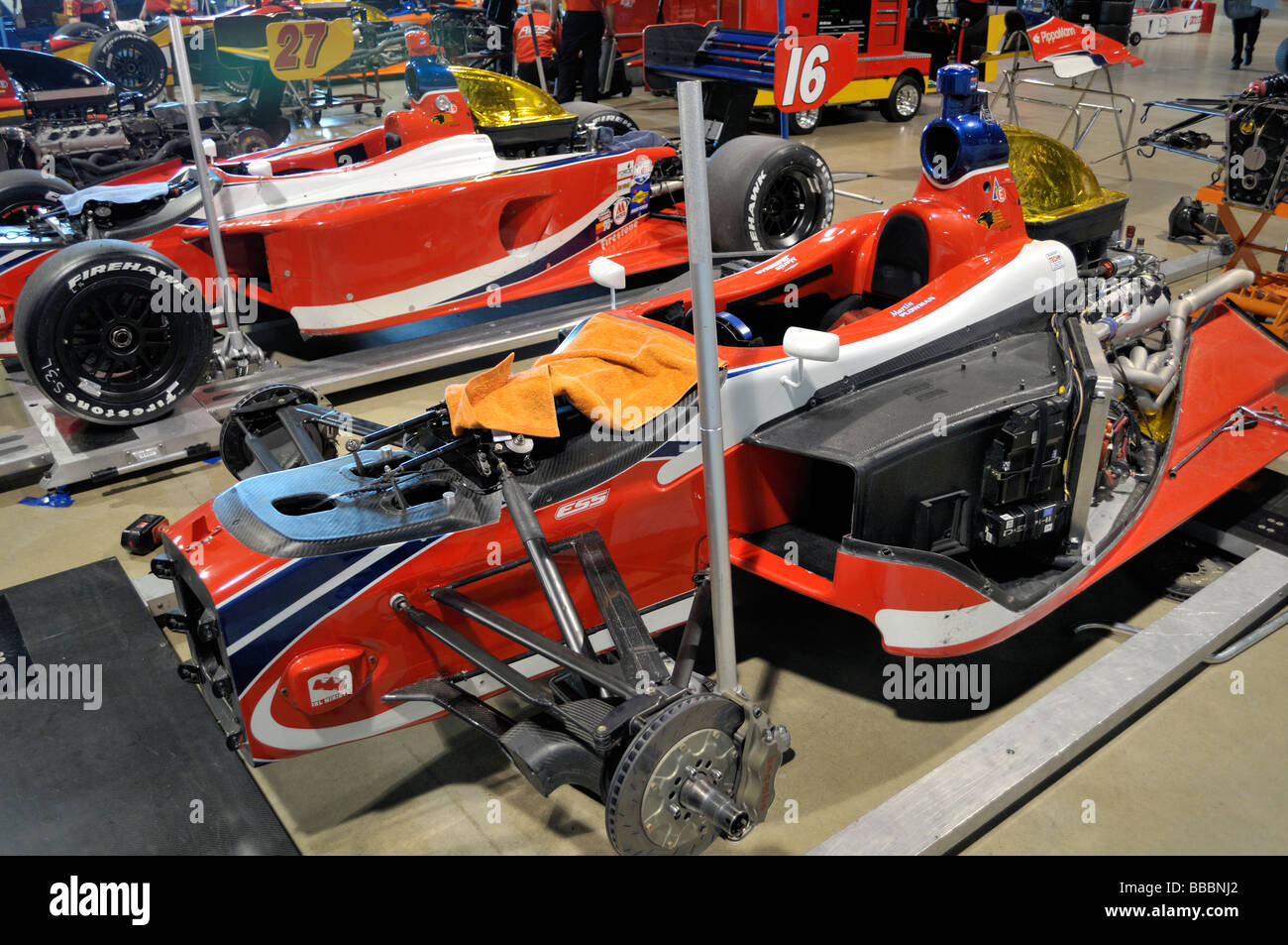Colorful Indy race cars partially disassembled - Stock Image
