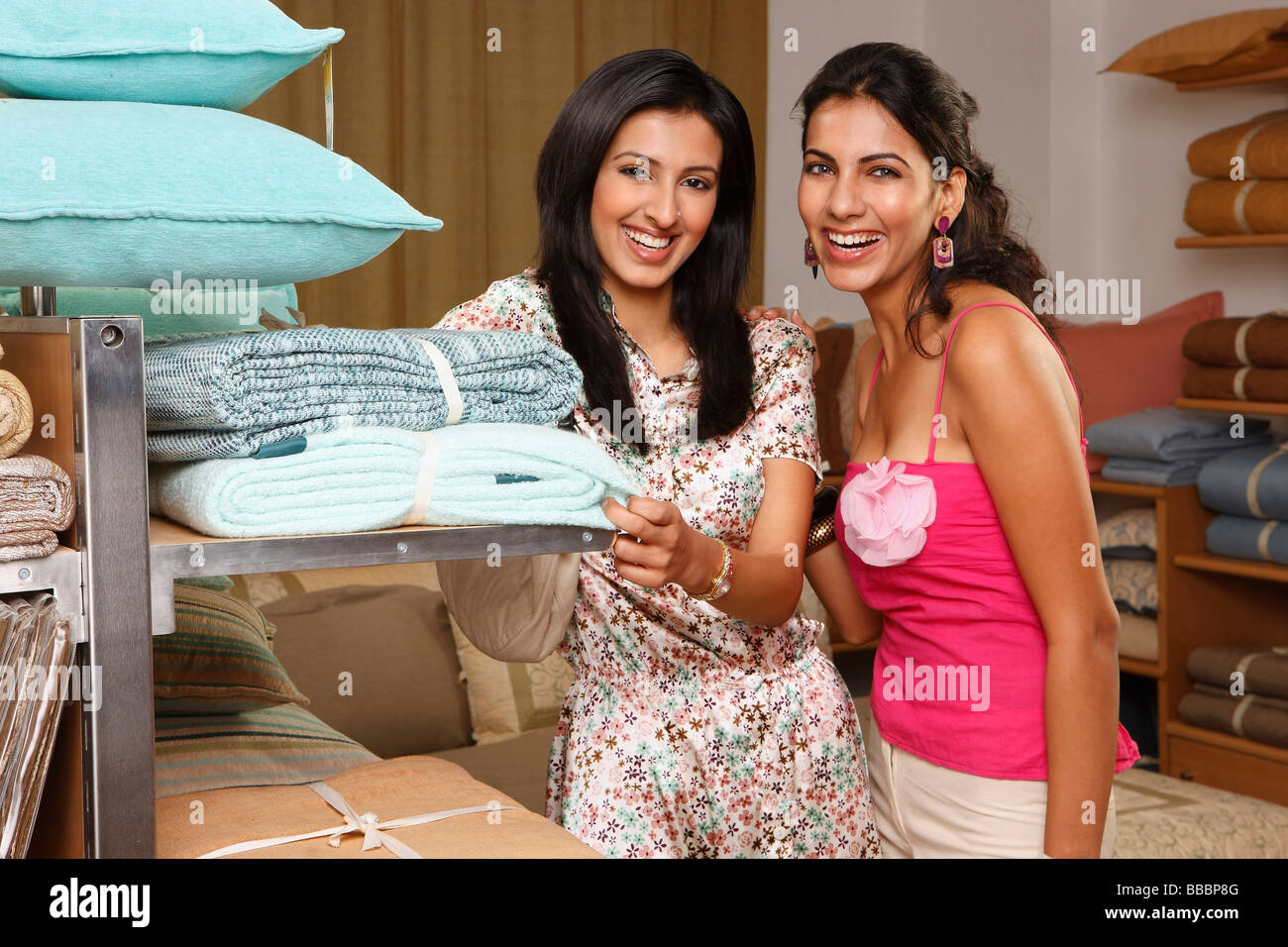 two women shopping for household items - Stock Image