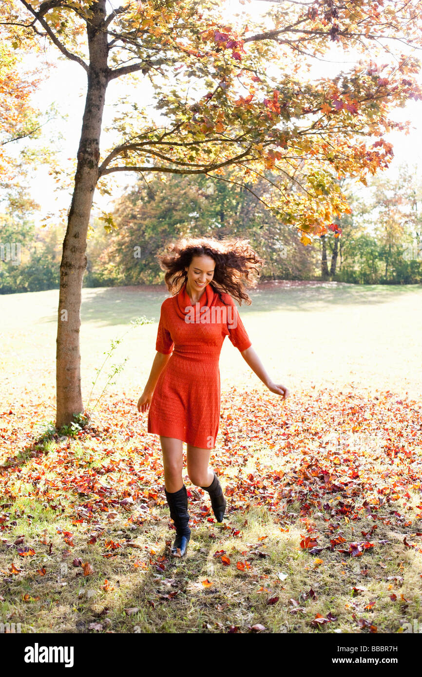 young woman running in meadow Stock Photo