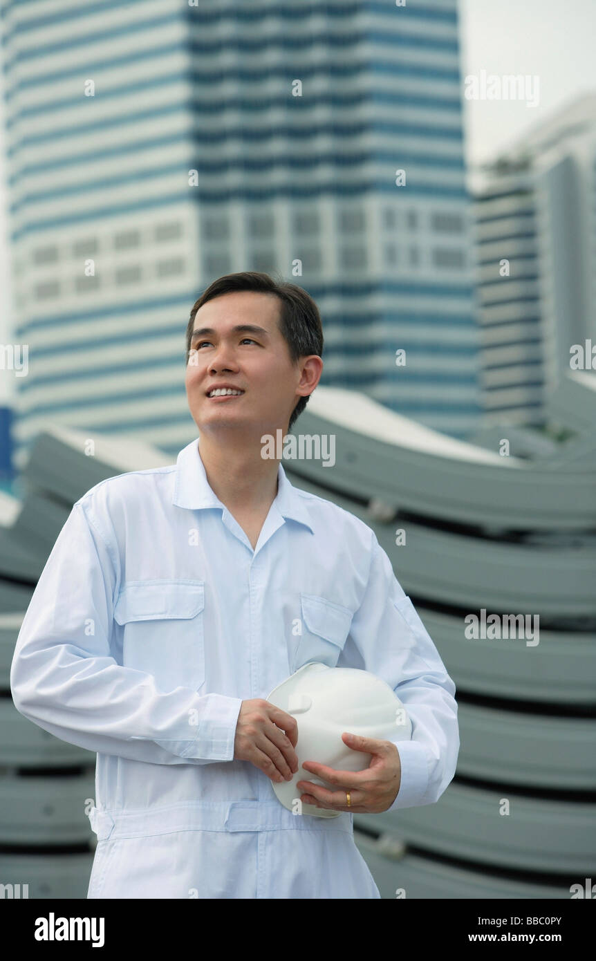 Man with hard helmet looking into distance Stock Photo