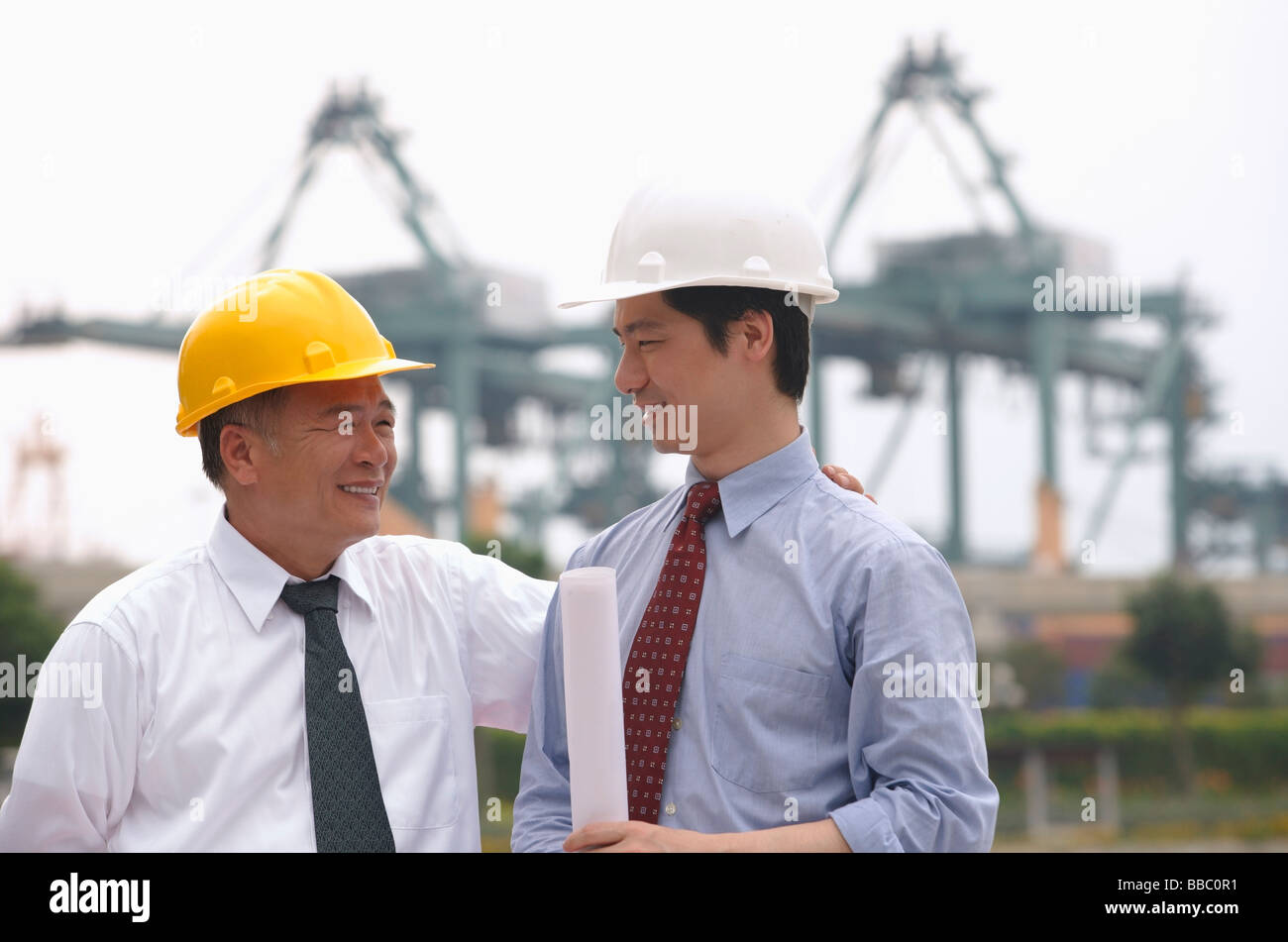 Men with helmets looking at each other - Stock Image