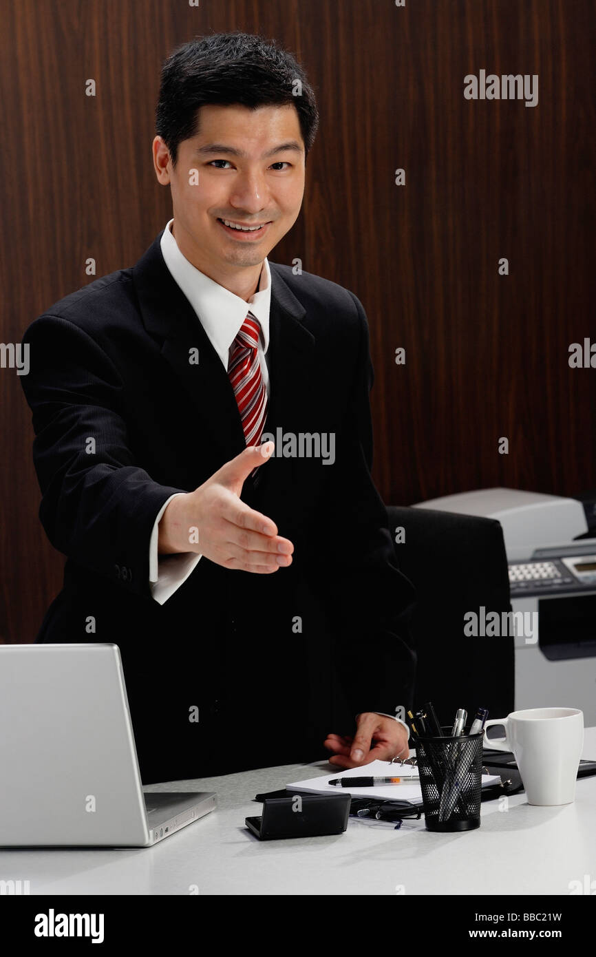 A businessman extends his hand to shake hands Stock Photo
