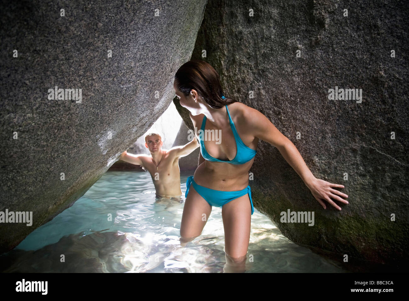 Woman and Man Exploring Cave - Stock Image