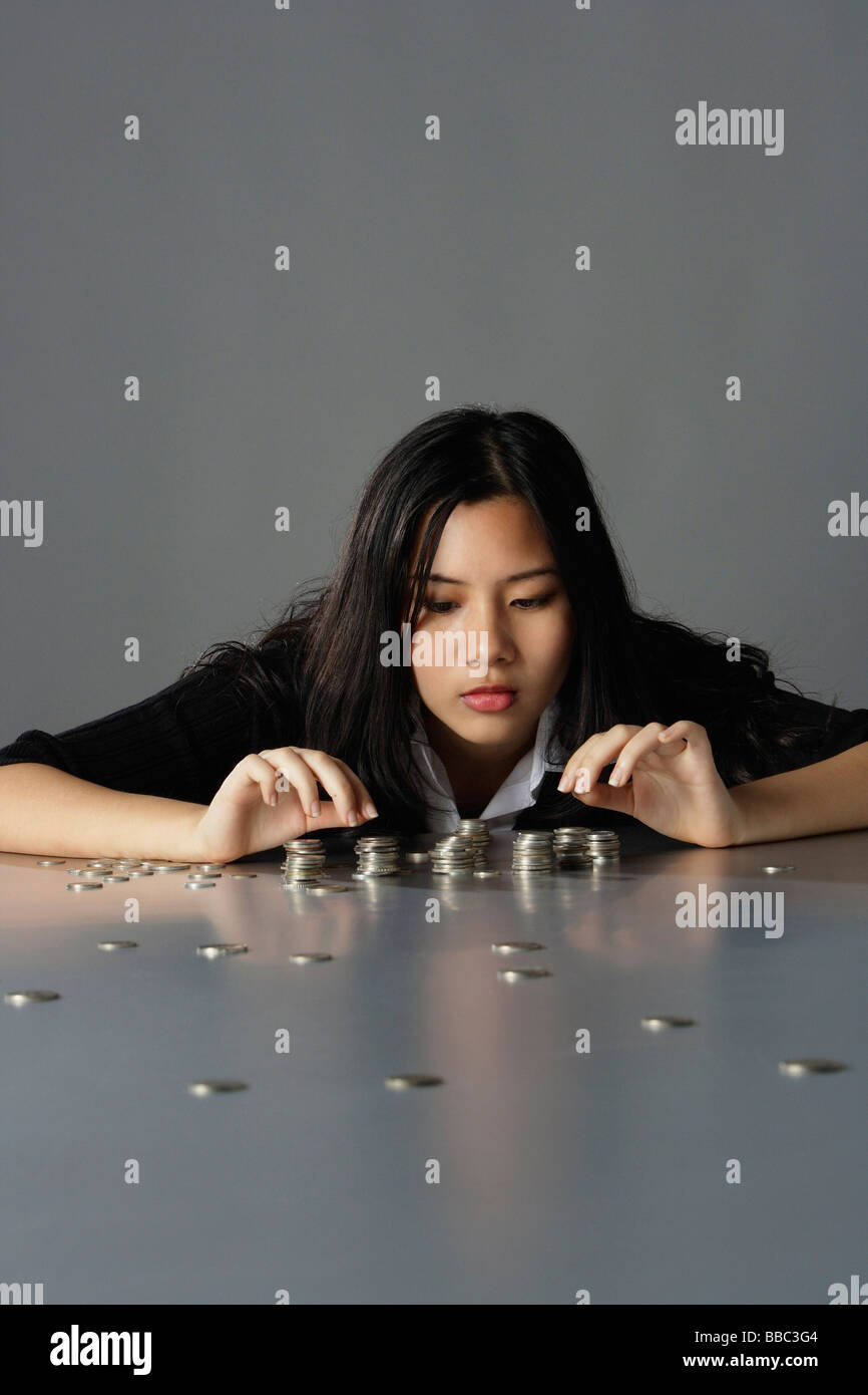 Young Chinese woman counting money Stock Photo